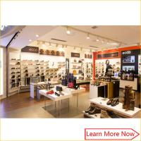 Customized fashion retail wall wood display shelf shoes store furniture Manufactures