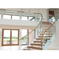 Solid Wood Apartment Stairs Carbon Steel Beam With Clear Tempered Glass Railing Manufactures
