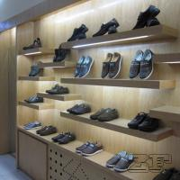 Top end wooden veneer men's retail shoe store design with led lights Manufactures