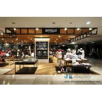 China Shopping Mall Clothing and Shoe store design by Wood display Koisk with shelves  in Wall and Black metal selling-counter on sale