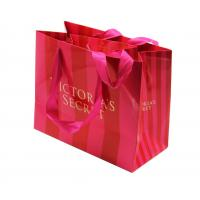 China custom printed striped paper shopping bags manufacturer with handle on sale