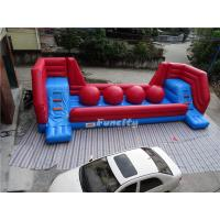 Red Tarpaulin Inflatable Jumping Castle / Wipeout Obstacle Course 10x4m Manufactures