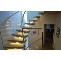 Stainless Steel Curved Glass Staircase Modern House Decoration With Wall Mounted Handrails Manufactures