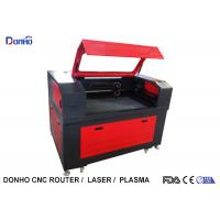 Black And Red Fabric Laser Cutting Machine with Honey Comb Table For Wood Engraving Manufactures