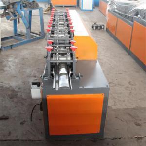 Galvanized Steel Guiding Column Shutter Door Roll Forming Machine Manufactures