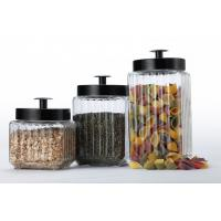 set of three glass canisters with metal lids ,different size and various colors  for storing Manufactures