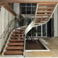 Indoor use wood step glass railing steel curved staircase Manufactures