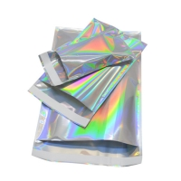 China Colorful Laser Self Sealing Aluminum Foil Envelopes Holographic Adhesive Courier Plastic Packaging Bags on sale