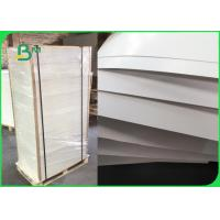 2 Side Coated Art Board Paper 157gsm Custom Size Uniform Surface Coating Manufactures